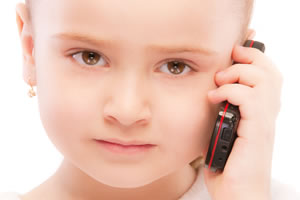 Child exposure to EMR whilst using mobile phone