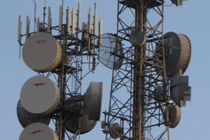 Directional transmitters move voice and data from one tower to the next. They can affect us from great distances.