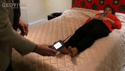 Dr Daya, wholistic medicine GP from London, shields bedroom against EMF radiation with Geovital